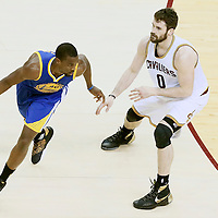 10 June 2016: Golden State Warriors forward Harrison Barnes (40) drives past Cleveland Cavaliers forward Kevin Love (0) during the Golden State Warriors 108-97 victory over the Cleveland Cavaliers, during Game Four of the 2016 NBA Finals at the Quicken Loans Arena, Cleveland, Ohio, USA.