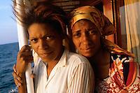 ca. April 1980, Caribbean --- Cuban Refugees Aboard a Boat --- Image by © Owen Franken/CORBIS