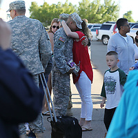 A soldier with the 1-185th Aviation Regiment in Tupelo gets one last hug before boading a bus headed to Ft. Hood to begin a 10 month deployment in Kosovo.