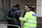 ARREST. A young black male is arrested on Ludgate Hill. It took 10 officers from various forces to overcome this man and arrest him securely. Community Support Officers, city of London Police and the Metropolitan Police.