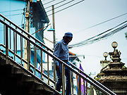 17 JULY 2015 - BANGKOK, THAILAND:     A man walks to Ton Son Mosque in Bangkok for Eid al-Fitr services. Eid al-Fitr is also called Feast of Breaking the Fast, the Sugar Feast, Bayram (Bajram), the Sweet Festival or Hari Raya Puasa and the Lesser Eid. It is an important Muslim religious holiday that marks the end of Ramadan, the Islamic holy month of fasting. Muslims are not allowed to fast on Eid. The holiday celebrates the conclusion of the 29 or 30 days of dawn-to-sunset fasting Muslims do during the month of Ramadan. Islam is the second largest religion in Thailand. Government sources say about 5% of Thais are Muslim, many in the Muslim community say the number is closer to 10%.          PHOTO BY JACK KURTZ