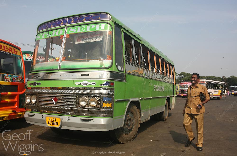 Local bus with conductor at Kannur bus station, Karnataka, India