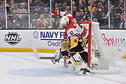 BOSTON, MA - MAY 09: Carolina Hurricanes center Greg McKegg (42) collides with Boston Bruins goaltender Tuukka Rask (40) in the 2nd period. During Game 1 of the Eastern Conference Finals featuring the Carolina Hurricanes against the Boston Bruins on May 09, 2019 at TD Garden in Boston, MA. (Photo by Michael Tureski/Icon Sportswire)