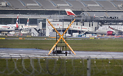© Licensed to London News Pictures. 06/04/2020. London, UK. A large illuminated 'X'  blocks the end of Heathrow's southern runway as the airport starts operations using only one runway. As the lockdown continues airlines will only take off and land from one runway alternating between the two every other week.  The United Kingdom has started a third week of lockdown in an attempt to halt the spread of the coronavirus Covid-19. Photo credit: Peter Macdiarmid/LNP