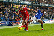 Alfredo Morelos of rangers tries to win the ball from Andrew Considine of Aberdeen FC during the William Hill Scottish Cup quarter final replay match between Rangers and Aberdeen at Ibrox, Glasgow, Scotland on 12 March 2019.