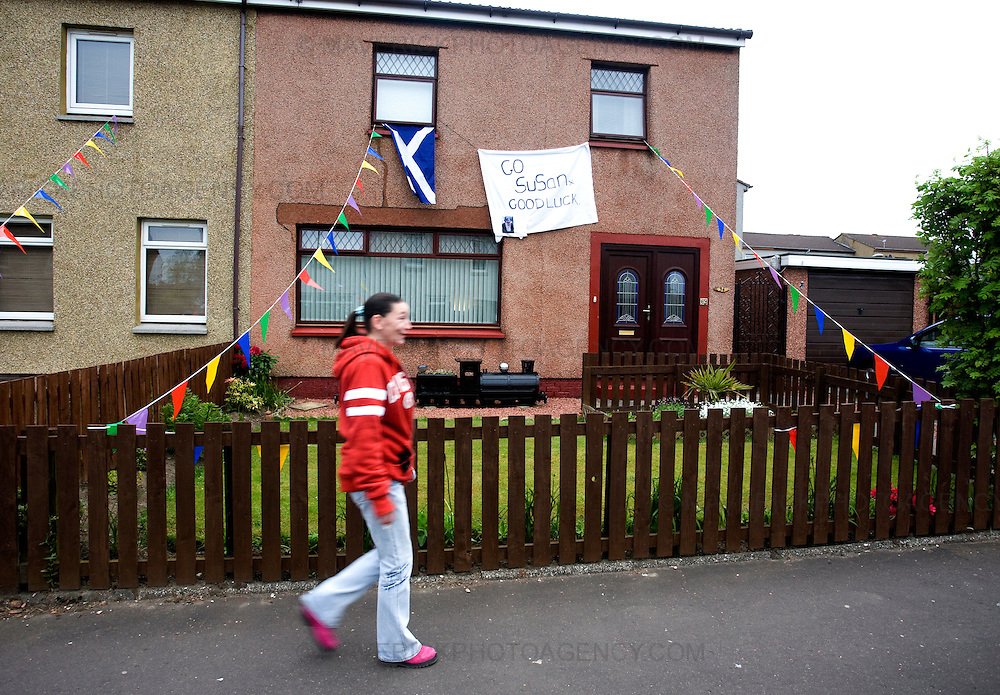 A women walks past a house in Blackburn West Lothian as neighbours, freinds  fans and locals from Blackburn come together to watch  Britain's Got Talent star Susan Boyle perform live in front of the nation for the first time tonight as she battles it out for a place in the show's final..The 48-year-old from West Lothian became a worldwide sensation after her audition performance of I Dreamed A Dream was screened last month...Picture Michael Hughes/Maverick ...