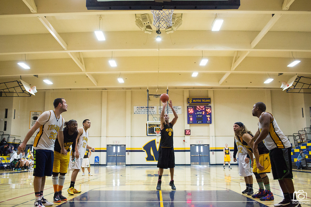 Class of 1997 alumni Steve Moore shoots a free-throw during the consolation championship game during the Milpitas High School Alumni Basketball Tournament at Milpitas High School in Milpitas, California, on January 3, 2015. (Stan Olszewski/SOSKIphoto)