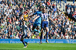 Jonas Olsson (SWE) of West Brom and Jonas Olsson (SWE) of West Brom compete in the air - Photo mandatory by-line: Rogan Thomson/JMP - 07966 386802 - 12/04/2014 - SPORT - FOOTBALL - The Hawthorns Stadium - West Bromwich Albion v Tottenham Hotspur - Barclays Premier League.