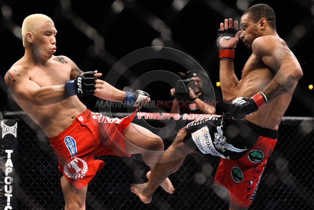 "ATLANTA, GEORGIA, SEPTEMBER 6, 2008: Ryo Chonan (left) blocks a kick from Roan Carneiro during ""UFC 88: Breakthrough"" inside Philips Arena in Atlanta, Georgia on September 6, 2008"