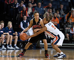 Virginia guard Sharnee Zoll (5) tries to steal the ball from Maryland guard Kristi Toliver (20).  The Virginia Cavaliers women's basketball team fell to the #4 ranked Maryland Terrapins 74-62 at the John Paul Jones Arena in Charlottesville, VA on January 18, 2008.