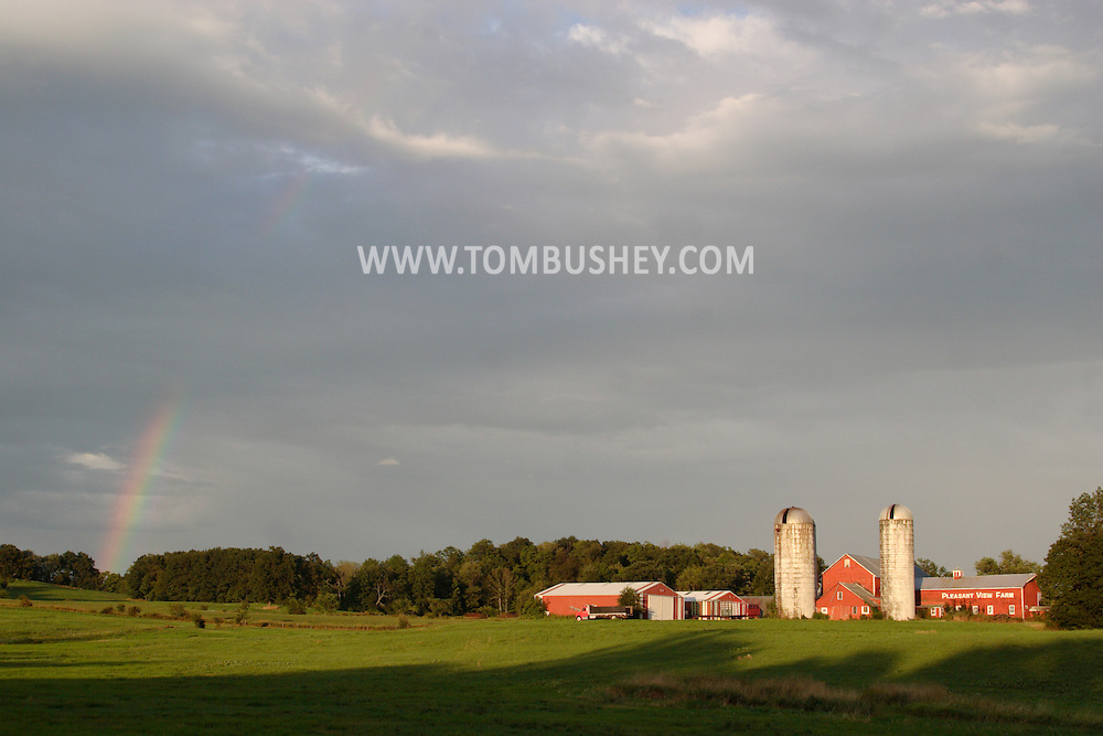 Montgomery, NY - The remains of a rainbow arc across the sky behind Pleasant View Farm on Aug. 2, 2008.