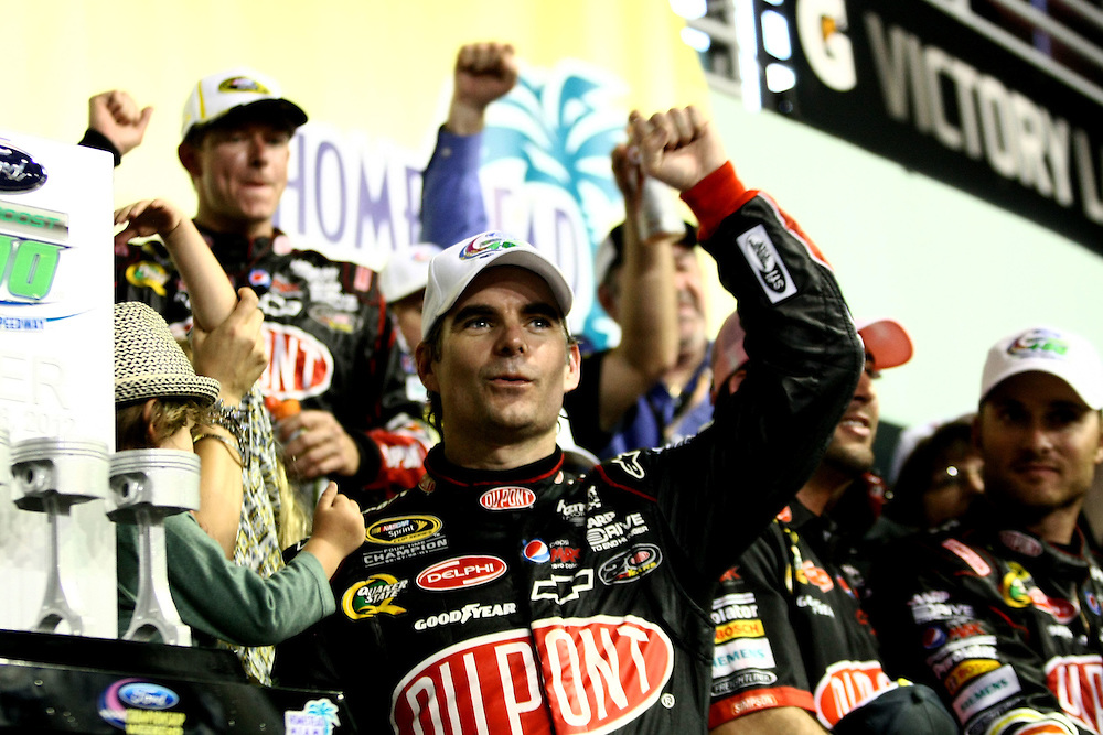 Nov 18, 2012; Homestead, FL, USA; NASCAR Sprint Cup Series driver Jeff Gordon celebrates in victory lane after winning the Ford EcoBoost 400 at Homestead Miami Speedway. Mandatory Credit: Douglas Jones-DDJ Sports Imaging