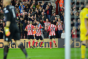 Southampton players celebrate Maya Yoshida goal during the Capital One Cup match between Southampton and Aston Villa at the St Mary's Stadium, Southampton, England on 28 October 2015. Photo by Adam Rivers.