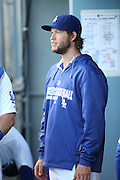 LOS ANGELES, CA - AUGUST 22:  Clayton Kershaw #22 of the Los Angeles Dodgers looks on from the dugout during the game against the New York Mets at Dodger Stadium on Friday, August 22, 2014 in Los Angeles, California. The Dodgers won the game 6-2. (Photo by Paul Spinelli/MLB Photos via Getty Images) *** Local Caption *** Clayton Kershaw