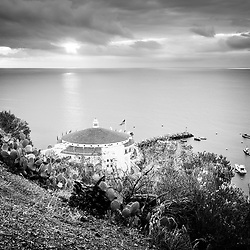 Catalina Island Avalon Casino sunrise black and white picture from above. Catalina Casino is a historic theatre built in the early 1900s by the Wrigley family. Catalina Island is a popular travel destination off the coast of Southern California in the United States.