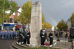 © Licensed to London News Pictures. 11/11/2018. Orpington, UK. Cadets stand with heads bowed at war memorial as a rainbow appears. Ex-transport minister and MP for Orpington Jo Johnson attending the Remembrance day service at Orpington war memorial to mark one hundred years since the end of the first world war.Photo credit: Grant Falvey/LNP
