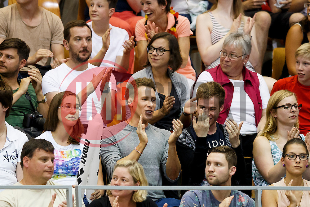 American screenwriter, director, film and television producer Dustin Lance Black cheers for his boyfriend Tom Daley of Great Britain during the Mens 10m Springboard Final  - Photo mandatory by-line: Rogan Thomson/JMP - 07966 386802 - 23/08/2014 - SPORT - DIVING - Berlin, Germany - SSE im Europa-Sportpark - 32nd LEN European Swimming Championships 2014 - Day 11.