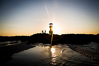 A lighthouse at sunset on Khao Lak beach, north of Phuket in Thailand.