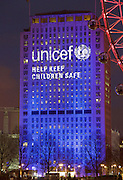 The Shell Building <br /> lit up in blue light with <br /> UNICEF Help Keep Children Safe <br /> <br /> <br /> The Mayor of London's New Year's Eve fireworks display at the Coca-Cola London Eye 31st December 2015 taken from the Royal Air Force Memorial on Victoria Embankment, London, Great Britain. illuminated with the Unicef cyan blue and joining forces with Edinburgh's Hogmanay in support of Unicef's Resolution for Children.<br /> <br /> Unicef will bring together thousands of revellers at two of the world's most famous New Year's Eve celebrations for a unifying moment, aimed at raising awareness and helping children whose lives have been turned upside down by the conflict in Syria. <br /> <br />   <br /> <br /> Photograph by Elliott Franks <br /> Image licensed to Elliott Franks Photography Services