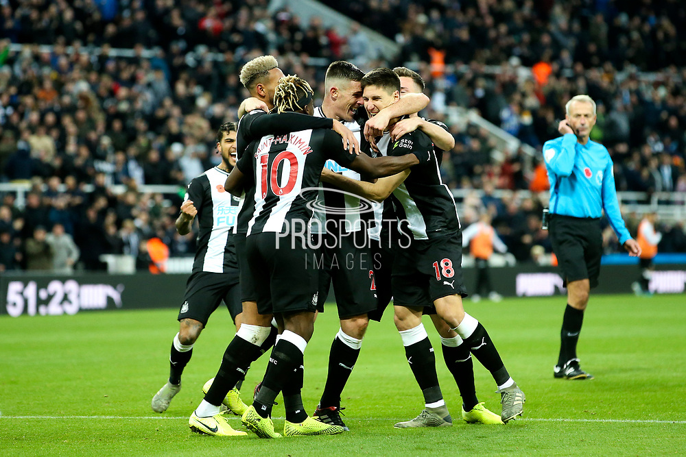 Ciaran Clark (#2) of Newcastle United celebrates Newcastle United's second goal (2-1) with Newcastle United teammates during the Premier League match between Newcastle United and Bournemouth at St. James's Park, Newcastle, England on 9 November 2019.