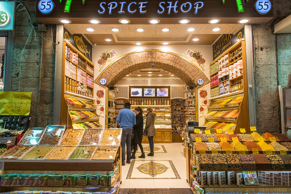Customers peruse the shelves of a spice shop at Istanbul Spice bazaar in Turkey