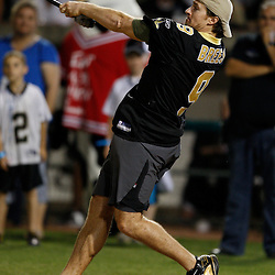 Apr 28, 2010; Metairie, LA, USA; Drew Brees (9) hits a home run during the Heath Evans Foundation charity softball game featuring teammates of the Super Bowl XLIV Champion New Orleans Saints at Zephyrs Field.  Mandatory Credit: Derick E. Hingle-US-PRESSWIRE.