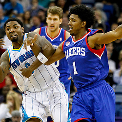 November 7, 2012; New Orleans, LA, USA; New Orleans Hornets shooting guard Roger Mason Jr. (8) and Philadelphia 76ers shooting guard Nick Young (1) get tied up scrambling for a loose ball during the second half of a game at the New Orleans Arena. The 76ers defeated the Hornets 77-62. Mandatory Credit: Derick E. Hingle-US PRESSWIRE
