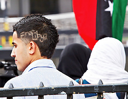 licensed to London News Pictures. LONDON, UK  17/04/2011. A anti-Gaddafi protester with Free Libya cut into his hair outside the Libyan Embassy on the anniversary of the murder of policewoman Yvonne Fletcher 27 years ago by a gunman shooting from the old embassy in St James Square. Please see special instructions for usage rates. Photo credit should read CLIFF HIDE/LNP