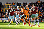 Burnley defender Michael Keane clears from Wolverhampton Wanderers striker Benik Afobe during the Sky Bet Championship match between Wolverhampton Wanderers and Burnley at Molineux, Wolverhampton, England on 7 November 2015. Photo by Alan Franklin.