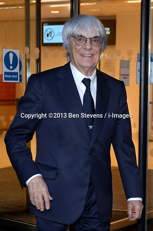 Bernie Ecclestone leaves the High Court after giving evidence in relation to an alleged fraudulent deal selling a stake in Formula One, London, United Kingdom. Wednesday, 6th November 2013. Picture by Ben Stevens / i-Images<br /> File photo - The Formula One boss, Bernie Ecclestone, has offered to make a $100m (£60m) payment to end his trial on bribery charges, a district court in Munich has said. State prosecutors told the court they would agree to accept his offer. Photo file o5/08/2014.