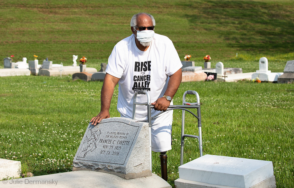 """Milton Cayette, Jr., Lavigne's brother and a member of RISE St. James, at his parents' grave site in St. James, Louisiana: """"We are more susceptible to the coronavirus because of the poison in our water, soil, and air. This virus will attack the people with weaker immune systems."""" He tries not to allow himself to be afraid of getting the virus because he believes God will protect him."""