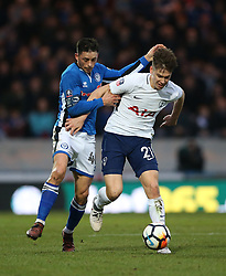 Rochdale's Ian Henderson (left) andTottenham Hotspur's Juan Foyth battle for the ball