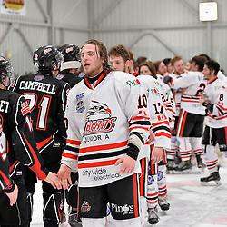"""FORT FRANCES, ON - May 2, 2015 : Central Canadian Junior """"A"""" Championship, game action between the Fort Frances Lakers and the Soo Thunderbirds, Championship game of the Dudley Hewitt Cup. Matt Pinder #10 of the Soo Thunderbirds shakes hands with the Fort Frances Lakers.<br /> (Photo by Shawn Muir / OJHL Images)"""