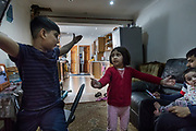 London, England, UK, June 1 2018 - Asia Bibi's daughter Ajwa (red) and her brother discuss the size of the rats they encounter everyday in the house.<br /> Asia Bibi lives with her 3 kids and her cousin in a 3 bedroom flat on the groundfloor of a terraced house in Walthamstow, East London. The landlord fails in his duty of doing a proper maintenance of the apartment.<br /> London is facing a major housing crisis, due to rising cost and under-supply.