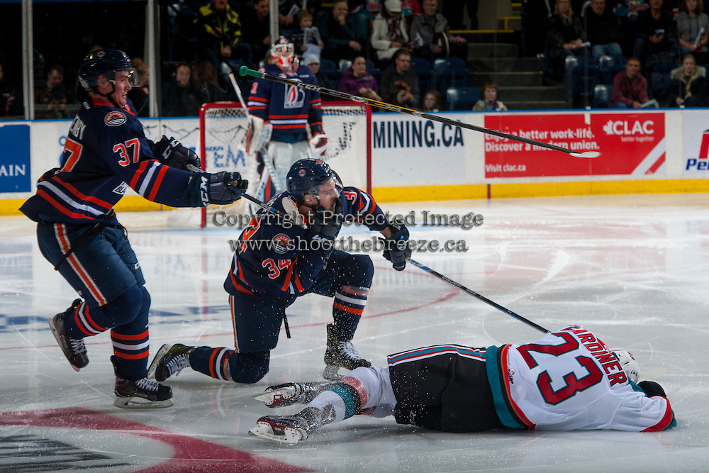 KELOWNA, CANADA - JANUARY 7: Reid Gardiner #23 of the Kelowna Rockets loses his stick after a hit on Deven Sideroff #34 of the Kamloops Blazers on January 7, 2017 at Prospera Place in Kelowna, British Columbia, Canada.  (Photo by Marissa Baecker/Shoot the Breeze)  *** Local Caption ***