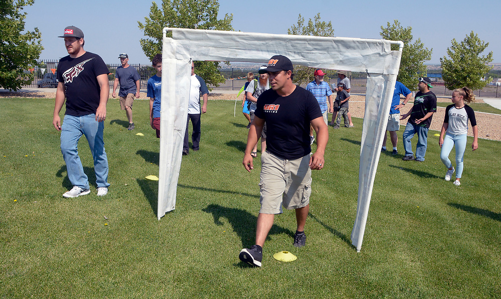 gbs062517g/ASEC - Justin Carr, left, and Shaun Taylor, right, with Southwest Pod Racing, lead a group through the drone racing course during the Drone Discovery Day at the Anderson Abruzzo Albuquerque International Balloon Museum on Sunday, June 25, 2017. (Greg Sorber/Albuquerque Journal)