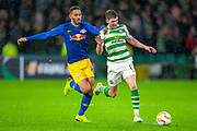 Matheus Cunha (#20) of RB Leipzig pulls back Ryan Christie (#17) of Celtic FC during the Europa League group stage match between Celtic and RP Leipzig at Celtic Park, Glasgow, Scotland on 8 November 2018.