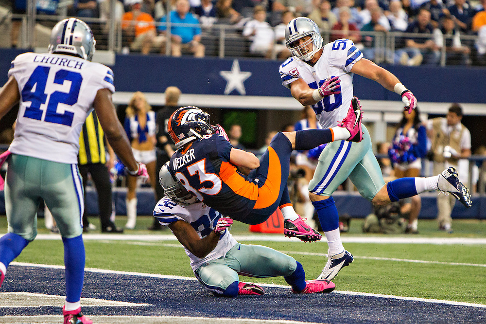 ARLINGTON, TX - OCTOBER 6:  Wes Welker #83 of the Denver Broncos catches a touchdown pass in front of Orlando Scandrick #32 of the Dallas Cowboys at AT&T Stadium on October 6, 2013 in Arlington, Texas.  The Broncos defeated the Cowboys 51-48.  (Photo by Wesley Hitt/Getty Images) *** Local Caption *** Wes Welker; Orlando Scandrick