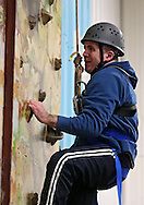 Chris Dougherty of Cedar Rapids works his way up the climbing wall during the Retreat & Refresh Stroke Camp at Camp Courageous in Monticello on Saturday, April 20, 2013. Dougherty had a stroke six years ago.