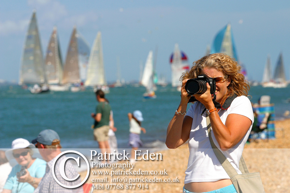 Woman taking photograph Cowes Week. Isle of Wight Yachting Sailing photography photograph canvas canvases