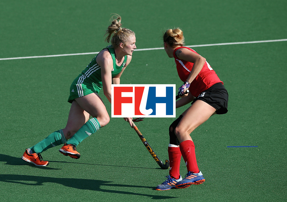 JOHANNESBURG, SOUTH AFRICA - JULY 12: Hannah Matthews of Ireland and Bianca Strubbe of Poland battle for possession during day 3 of the FIH Hockey World League Semi Finals Pool A match between Ireland and Poland at Wits University on July 12, 2017 in Johannesburg, South Africa. (Photo by Jan Kruger/Getty Images for FIH)