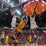 31 January 2017:  The San Diego State Aztecs men's basketball team hosts Wyoming Tuesday night at Viejas Arena. San Diego State forward Matt Shrigley (23) and guard Dakar Allen (4) block a shot by Wyoming guard Jason McMananmen (23) in the second half. The Aztecs beat the Cowboys 77-68 at half time. www.sdsuaztecphotos.com