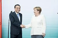 10 JUL 2018, BERLIN/GERMANY:<br /> Li Keqiang (L), Ministerpraesident der VR China, und Angela Merkel (R), CDU, Bundeskanzlerin, nach einer Praesentation zum autonomen Fahren mit deutschen Autoherstellern, Flughafen Tempelhof<br /> IMAGE: 20180710-01-119<br /> KEYWORDS: Handshake