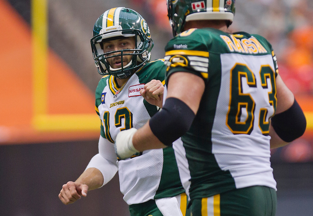 Edmonton Eskimos QB Mike Reilly celebrates a touchdown with Brian Ramsay against the B.C. Lions during the second half of their CFL football game in Vancouver, British Columbia, June 28, 2014. REUTERS/Kevin Light (CANADA)