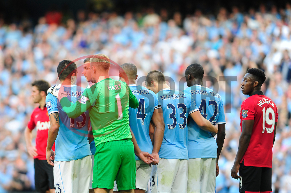 Manchester City's Joe Hart sets up his wall - Photo mandatory by-line: Dougie Allward/JMP - Tel: Mobile: 07966 386802 22/09/2013 - SPORT - FOOTBALL - City of Manchester Stadium - Manchester - Manchester City V Manchester United - Barclays Premier League