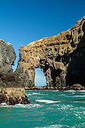 Sea arch along the coastal cliffs of Banks Peninsula, New Zealand