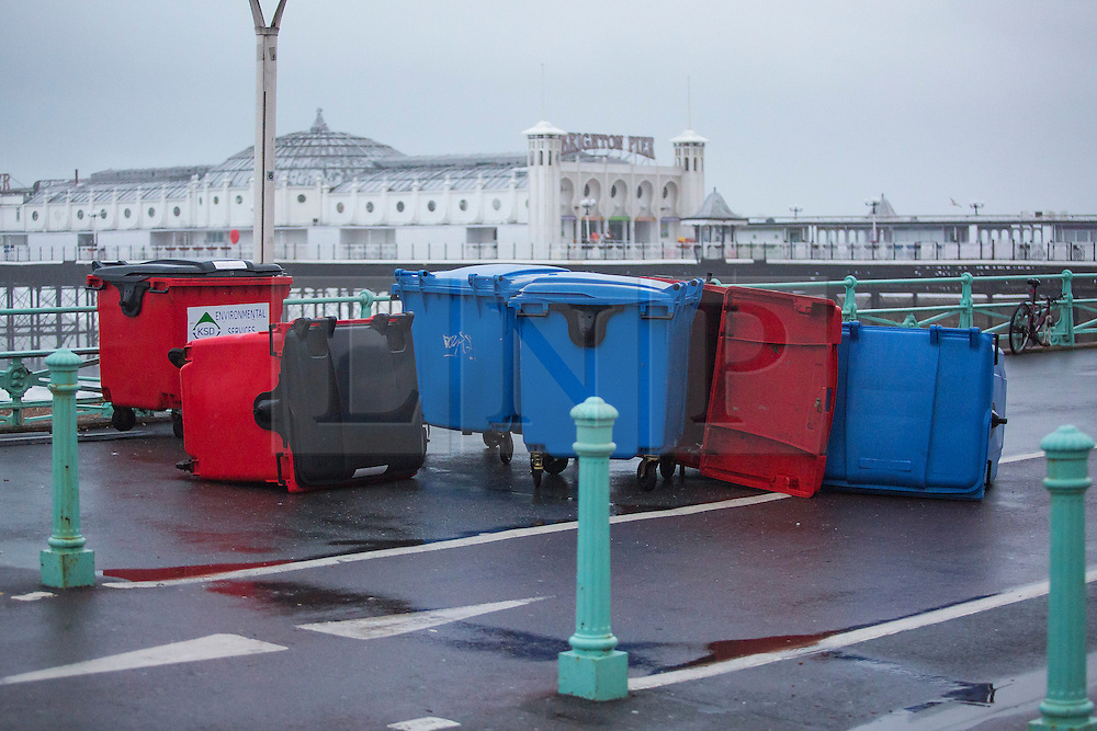 Brighton, UK. 20/11/2016, Bins lie strewn across the Brighton Promenade after being blown around during the onslaught of storm Angus who hit Brighton and Hove overnight with strong waves and powerful 80mph winds. Photo Credit: Hugo Michiels