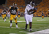 October 15, 2011: Northwestern Wildcats wide receiver Demetrius Fields (8) pulls in a pass as Iowa Hawkeyes cornerback Micah Hyde (18) defends during the second half of the NCAA football game between the Northwestern Wildcats and the Iowa Hawkeyes at Kinnick Stadium in Iowa City, Iowa on Saturday, October 15, 2011. Iowa defeated Northwestern 41-31.