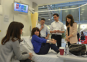 © Licensed to London News Pictures. 24/01/2013. London, UK (Sitting on Left) Daughetr of patient Sheree Murphy (On Bed) Heather Murphy (L-R) Andy Burnham, Ed Miliband, Liz Kendall. Leader of the Labour Party, Ed Miliband, Shadow Health Secretary Andy Burnham and Shadow Health Minister Liz Kendall visit the Macmillan Cancer Centre at University College Hospital in Central London today, 24 January 2013. Today the Labour Party launched its Whole Person Care policy review. Photo credit : Stephen Simpson/LNP