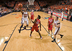 Virginia guard Sean Singletary (44) beats Maryland forward Bambale Osby (50) to the basket.  The Virginia Cavaliers defeated the Maryland Terrapins 91-76 at the University of Virginia's John Paul Jones Arena  in Charlottesville, VA on March 9, 2008.